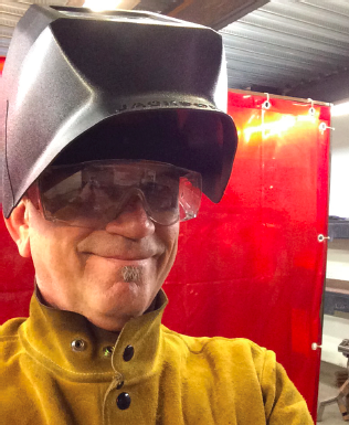Taking a break from welding at the Crucible in Oakland