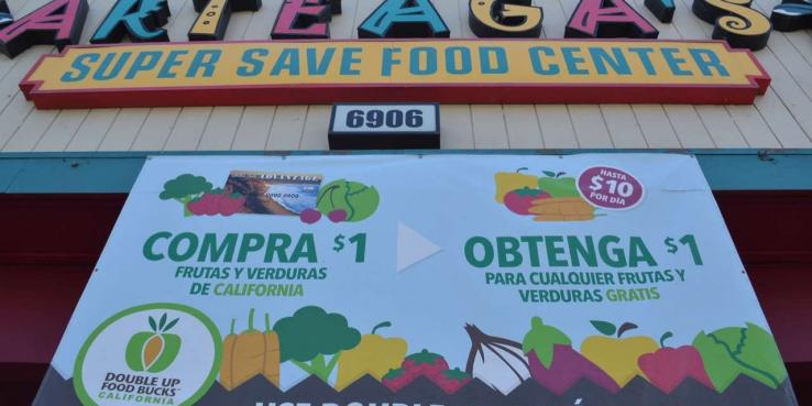 New research shows that programs like SPUR's Double Up Food Bucks, advertised here at Arteaga's Food Center in Gilroy, provide a positive economic boost to local economies.